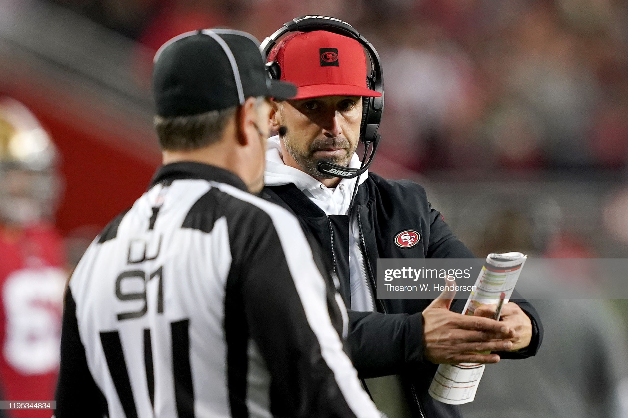 Working the official? Putting a bug in their ear? What exactly was Kyle Shanahan doing?