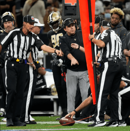Brad Rogers crew measures for a first down (New Orleans Saints).