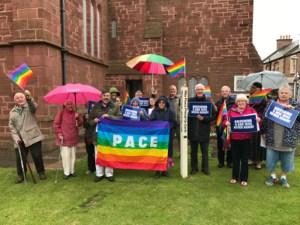 The Hiroshima vigil at St. Anne's Church, Dunbar, with an Italian Peace flag