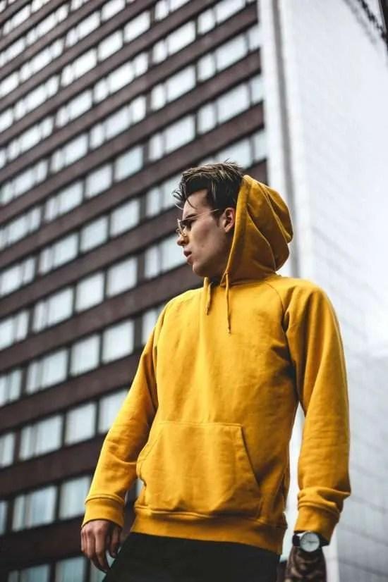 photography of guy wearing yellow hoodie