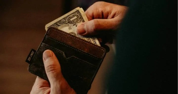 Money transaction aided by a wallet, banknotes being stored or taken out as income is earned or spent