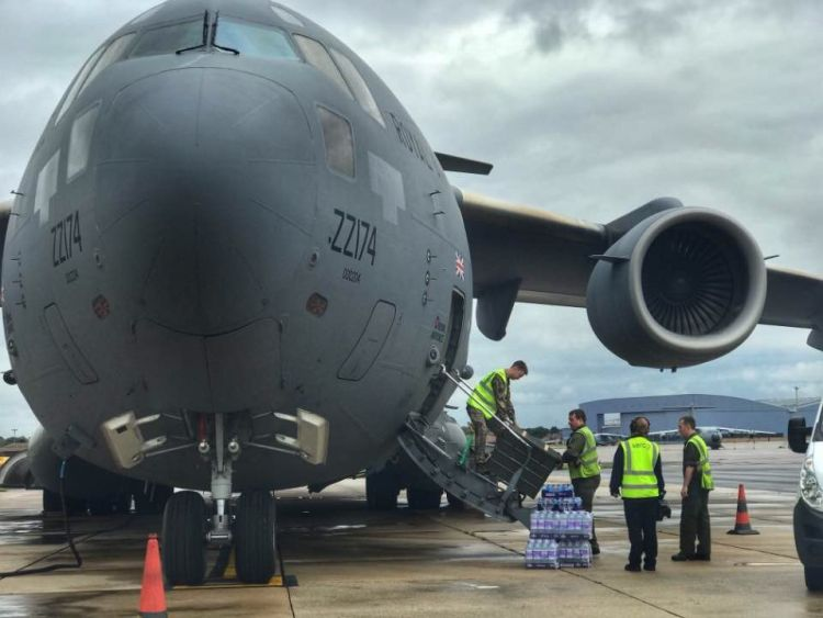 Aid supplies are loaded onto an RAF transport plane following Hurricane Irma