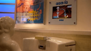 SEGA (YES, IT STILL EXISTS) RELEASES URINAL-BASED GAME…Gives New Meaning to the Phrase 'Pissing Contest'