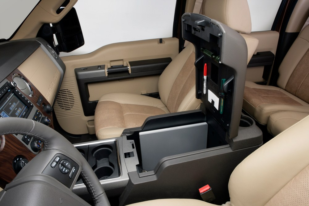 medium resolution of the rear facing portion of the 2011 ford super duty s flow through console includes two more cup holders a 12 volt powerpoint a 110 volt inverter socket