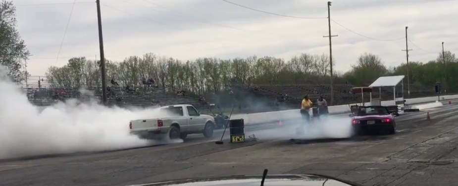 Ford Ranger beats a Miata in a burnout competition.