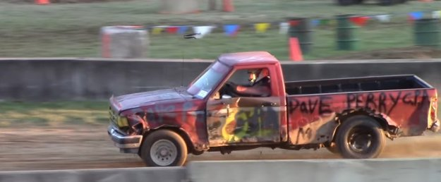 Destroyed Ford Range Race Truck Side