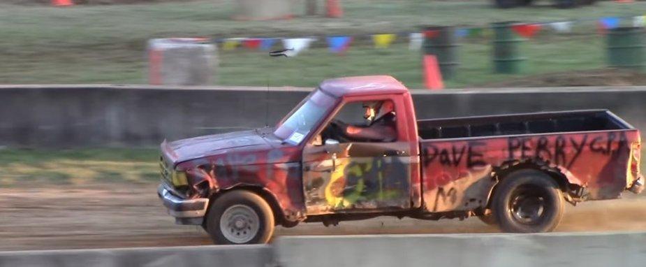 Destroyed Ford Range Race Truck Side