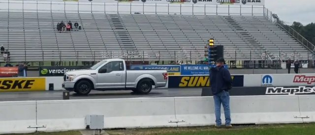 Silver F-150 Running 11s Side
