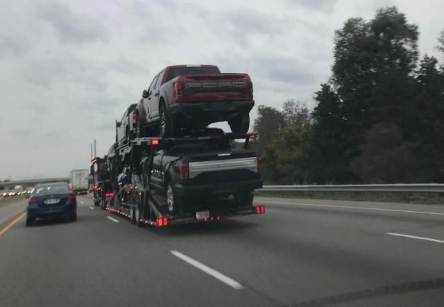 New Ford F-150 SVT Raptor on a transport truck.