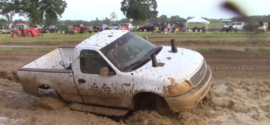 White Ford F-150 Mud Racer Stuck