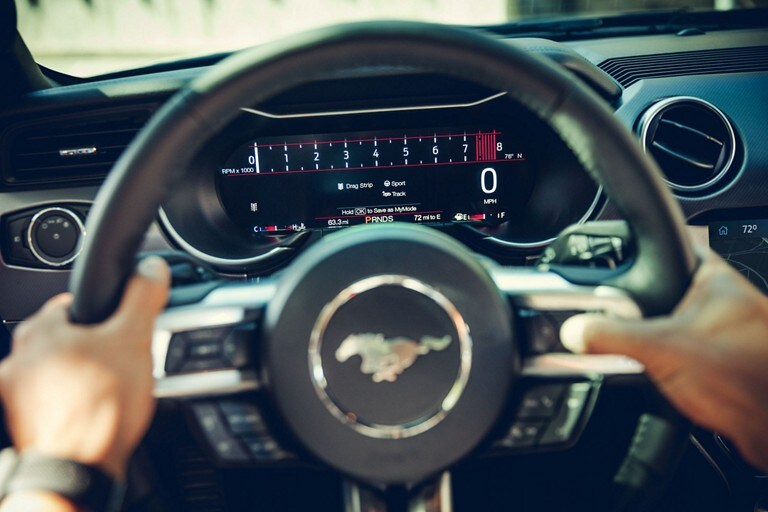 Hands on the wheel of a 2020 Ford Mustang