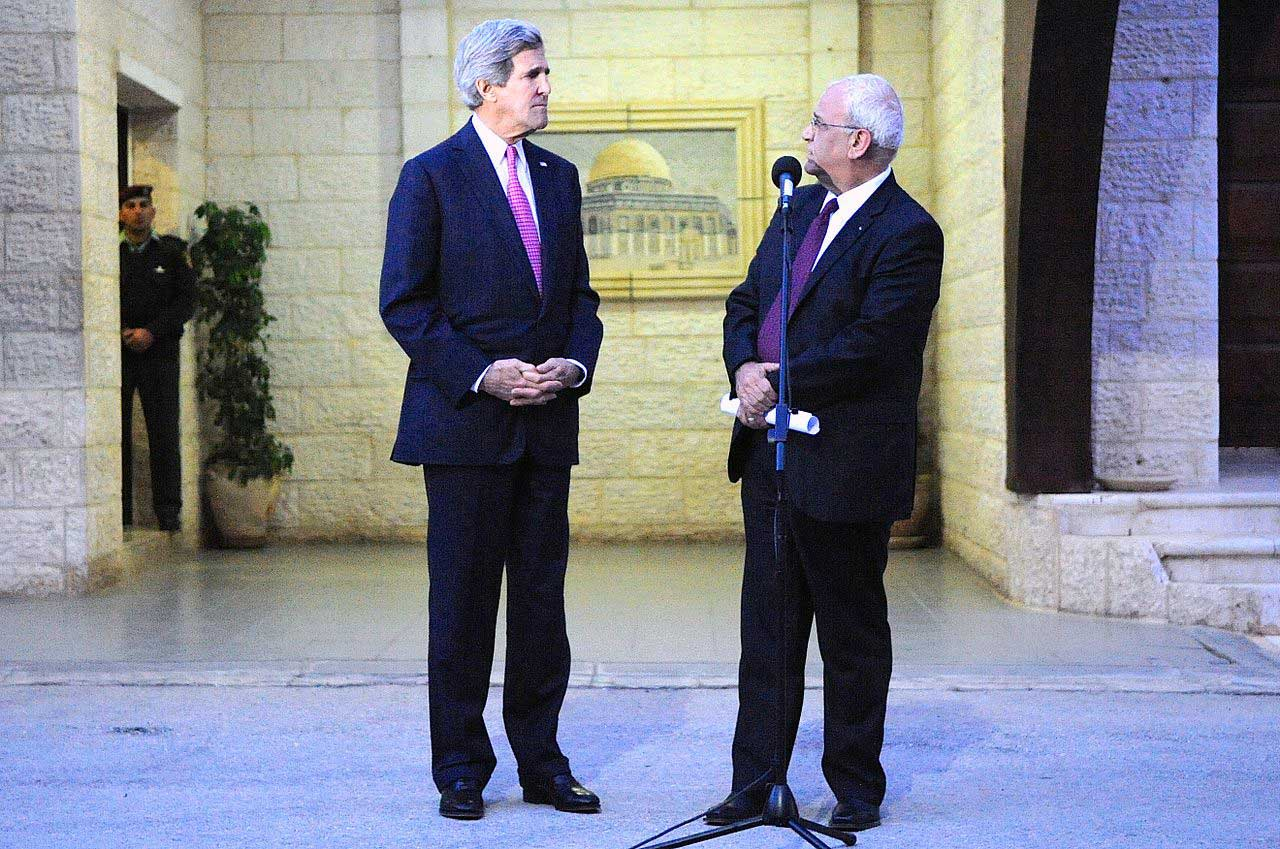 Palestinian Authority Lead Negotiator Saeb Erekat faces U.S. Secretary of State John Kerry as both address reporters following a meeting focused on Middle East peace at the Muqata'a Presidential Compound in Ramallah, West Bank, on January 4, 2013. (US State Department)