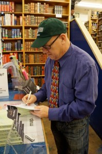 Stevan Allred signs copies of A Simplified Map of the Real World at Powell's.