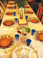 Seder table, by Wikipedia user Gilabrand.