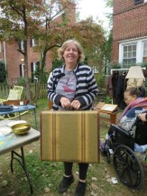 Debra Graham with her vintage suitcase, ready to go.