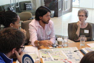 Andrea Limauro, center, with a team from the Van Ness Vision Committee at a June 2013 Vibrant Streets workshop.