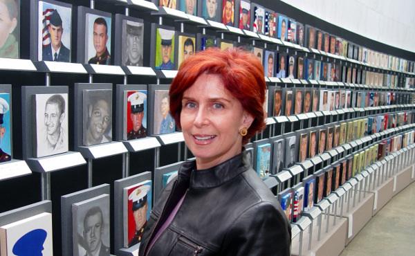 "The artist with the""Faces of the Fallen"" exhibit. (photo provided by Annette Polan)"