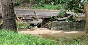 It looks like part of Broad Branch Road is about to end up in Broad Branch Stream