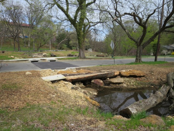Part of the Broad Branch stream daylighting project, with a new road surface and sidewalk.