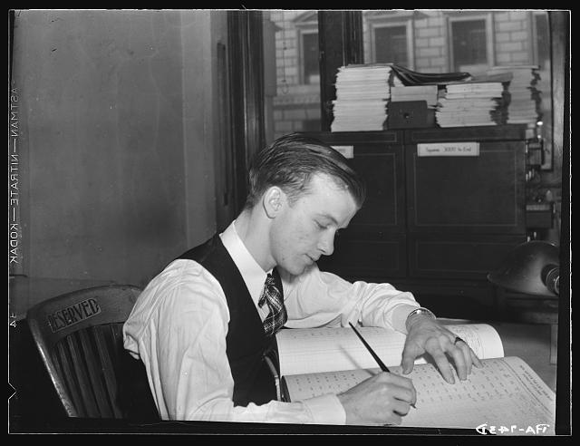 A government tax worker in 1935 (photo from loc.gov)