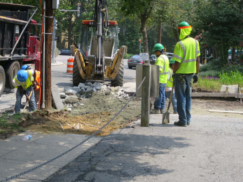 Workers tore up the existing concrete at the alley's entrance at Albemarle Street.