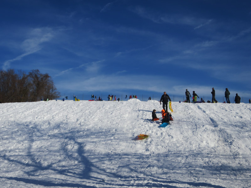 Having fun on Fort Reno's sledding hill