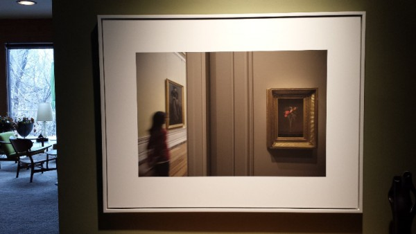 """A photo from Max Hirshfeld's """"Looking at Looking"""" series hangs in Robin Rose's entryway."""
