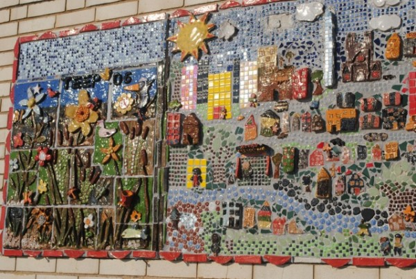 Rosalia's mosaic mural faces the Anacostia River.