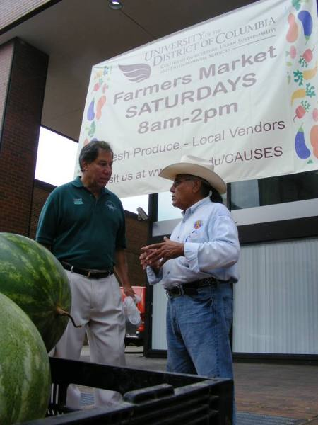 Mr. Avalos chats with Rudy Arredondo, President of the National Latino Farmers and Ranchers Trade Association. (photo courtesy of UDC CAUSES)