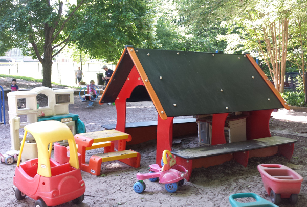 The little red playhouse and some of the toys that need new homes.