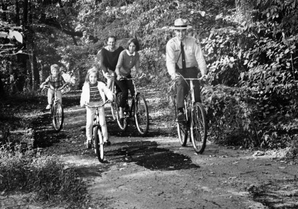 A ranger leads a family on a bike ride, September 1967. (photo provided by NPS)