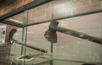 An iron with a wood handle from the late 1700's is seen in the Potawatomi collection inside the Forest Park Public Library on Des Plaines Avenue, which will remain on display until Aug. 11. | Alexa Rogals/Staff Photographer