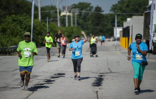 Runners get ready to cross the finish line on Saturday, Aug. 3, during the annual Miles 4 Missions Run and Walk outside of Living Word Christian Center on Roosevelt Road in Forest Park. | ALEXA ROGALS/Staff Photographer
