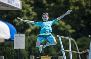 Kids do flips and dives off the diving board and generally keep cool at the pool last Saturday. | Alexa Rogals/Staff Photographer