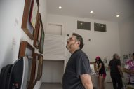 Paul Booth, of Forest Park, looks at artwork on Saturday, Aug. 24, 2019, during the annual Garage Galleries throughout Forest Park | ALEXA ROGALS/Staff Photographer