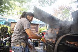 Pit master from Pit Zone BBQ checks on a slab of ribs. | Photo by Alex Rogals