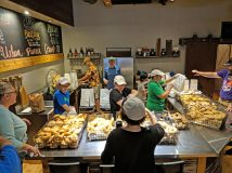 Daly's family and staff serve bagels in Urban Pioneer Group's expanded kitchen, which provides ample space for prep, display and sales. | JASON MAXHAM/Contributor
