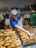 Daly's son Patrick bags bagels.   JASON MAXHAM/Contributor
