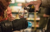 Steve Carter, of Glen Ellyn, serves samples of wine to participants on Nov. 2, during the annual Fall Wine Walk and Shop event at Centuries and Sleuth's bookstore on Madison Street in downtown Forest Park. | ALEX ROGALS/Staff Photographer