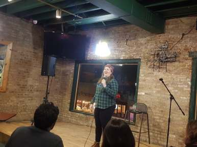 Comedian Molly Kearney, who has appeared on Comedy Central, brings big laughs to the crowd at Doc Ryan's on Nov. 8. Kearney was part of the final Faux Pas Comedy Show of 2019, sponsored by the Forest Park Arts Alliance. | Photo by Maria Maxham