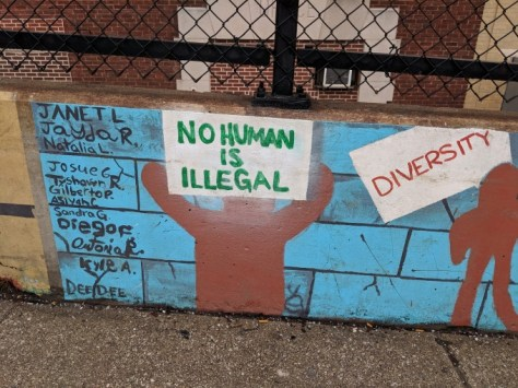 """The mural with the words """"No Human is Illegal"""" has been vandalized repeatedly over the past nine months."""
