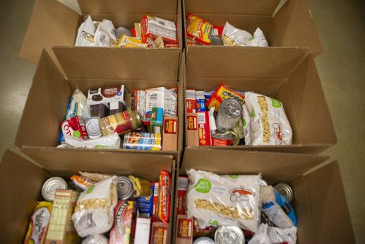 Non perishable food items are seen in the thanksgiving meal delivery boxes on Wednesday, Nov. 27, 2019, at the Howard Mohr Community Center on Des Plaines Avenue in Forest Park, Ill. | ALEX ROGALS/Staff Photographer