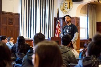 George Bunn, a history teacher at Proviso East, gives a presentation on Fred Hampton and his impact in the community earlier this month. | Photo by Shanel Romain