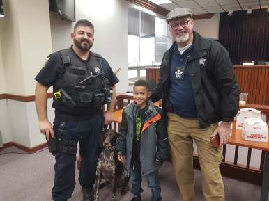 Forest Park Officer Dan Miller, police dog Madison, second-grader Theo Christo and Detective Jarlath Heveran met at the Westchester Police Department before heading over to Walmart in Forest Park for some holiday shopping, followed by a pizza party.