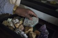 Fred Bryant holds a piece of rock from the K2 Mountain. | Alex Rogals, Staff Photographer