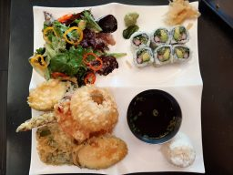 Bento: Inari's lunch special bento box. Shown here with tempura vegetables, salad, rice and California roll. (Photo credit Melissa Elsmo)
