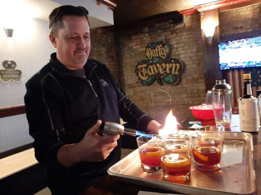 Ed Pogue fires wood to infuse whiskey and bourbon with smoke during Smoke, Fat and Whiskey, a March 1 collaborative food and drink pairing event at Duffy's Tavern, 7513 Madison St.