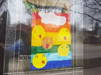"""Forest Park residents are participating in a window art project. The """"assignment"""" for March 20 was funny faces."""