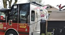 In a collaboration between the village of Forest Park and the park district, the Easter bunny rode along the streets of town on the back of a fire truck on April 12. | Jill Wagner, Contributing Photographer