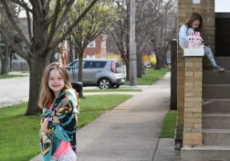 Residents stood outside their homes to watch the Easter bunny ride past on a Forest Park fire truck on April 12. | Jill Wagner, Contributing Photographer